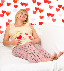 happy pregnant woman with hearts