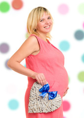 pregnant woman with heart and blue bow