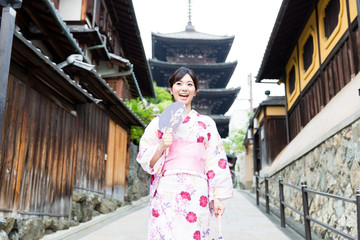 young asian woman wearing kimono walking