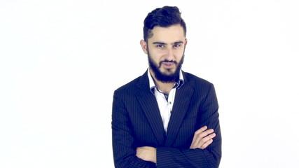 Serious young man with beard looking camera medium shot