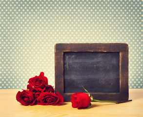 Blank rustic blackboard with roses