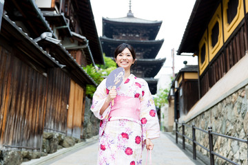 young asian woman wearing kimono walking