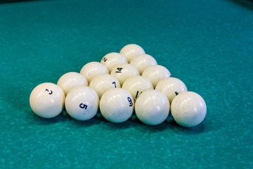 White balls forf Russian billiards on green