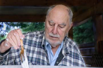 aged senior man painting