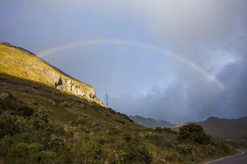 Andes mountains and rainbow near Quito