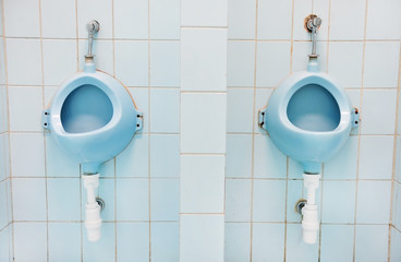 Two blue urinals