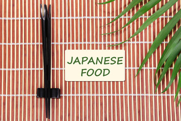Pair of chopsticks and Japanese Food text