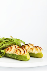 zucchini stuffed with pork and dressing recipe on a white backgr