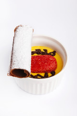 Cup of Zuppa inglese dessert with cocoa biscuit recipe on a whit