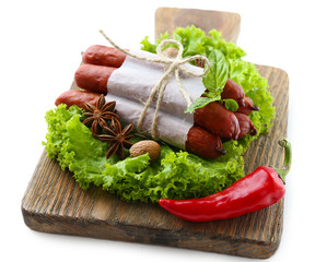 Smoked thin sausages  with lettuce salad leaves and spices