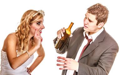 Wedding couple, bride with alcoholic drinking groom.