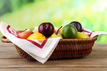 Assortment of juicy fruits in wicker basket