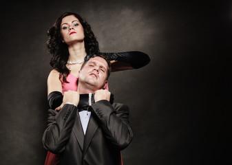 Woman in control of man