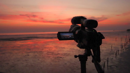 Video camera shooting twilight sky nature light background