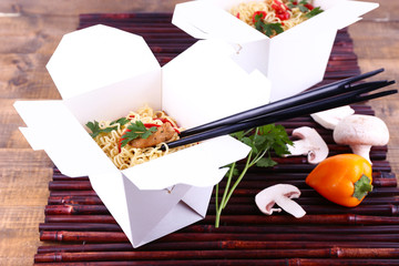 Chinese noodles in takeaway boxes