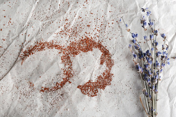 Traces of cocoa and sugar with dried flowers