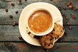 canvas print picture - Cup of coffee and tasty cookies on wooden background