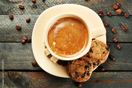 canvas print picture Cup of coffee and tasty cookies on wooden background