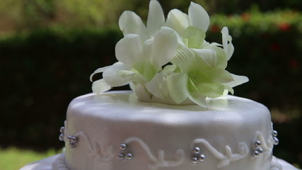 rotating closeup fresh white orchid and beads decorated wedding