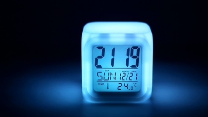 Clocks  with colored lighting at the night.