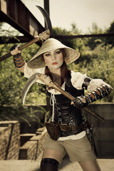 Beautiful attrctive female warrior holding two swords and fighti