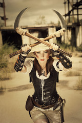 Beautiful attrctive agressive female warrior holding two swords