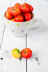 cherries on white wood background. . selective focus on cherry o