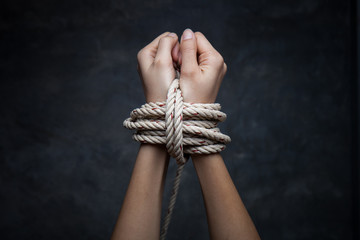 Hands of a missing kidnapped, abused, hostage, victim woman tied