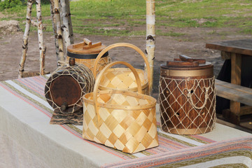 Baskets and kegs on a table