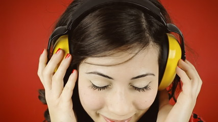 Music woman red headphones hands shy