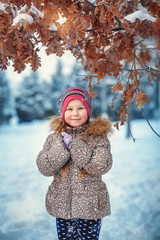 Little cute girl having fun in snow