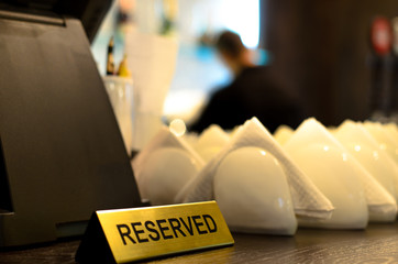 reserved sign and crockery on a bar counter