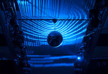 Disco Ball Hanging at Ceiling with Blue Lights