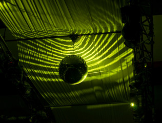 Disco Ball Hanging at Ceiling with Green Lights