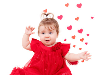 Adorable girl in red dress with a heart in the background