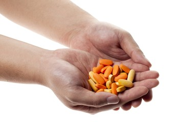 human hand holding medicines