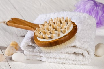 spa brush and towel