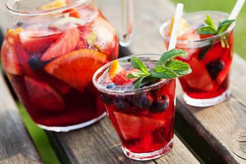 Refreshing sangria (punch) with fruits, picnic idea