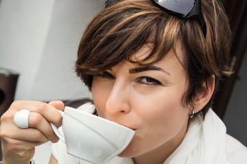 Young caucasian woman with coffee