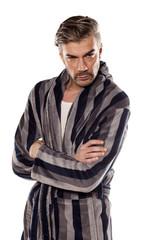 suspicious-looking man in a striped bathrobe
