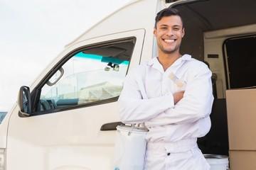 Painter smiling leaning against his van