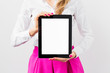 Leinwanddruck Bild - Woman holding ipad with empty white screen vertically