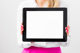 Woman holding ipad with empty white screen