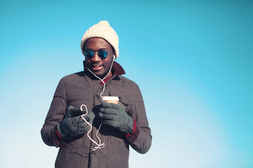 Lifestyle portrait of free young african man listening music