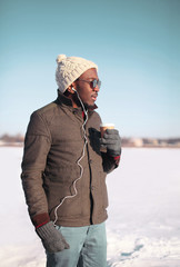Lifestyle portrait of free young african man and coffee