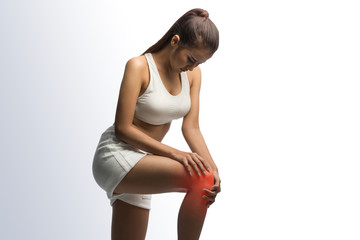 Woman having knee pain on a white background with clipping path