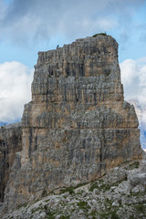 Climber on the top of one of the Cinque Torri mountain,Dolomites