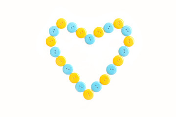 blue and yellow heart from plastic clasper