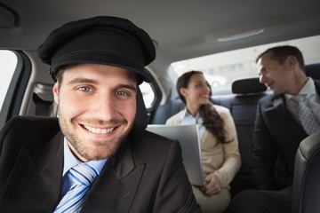 Handsome chauffeur smiling at camera
