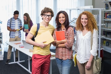 Students smiling at camera standing in a line
